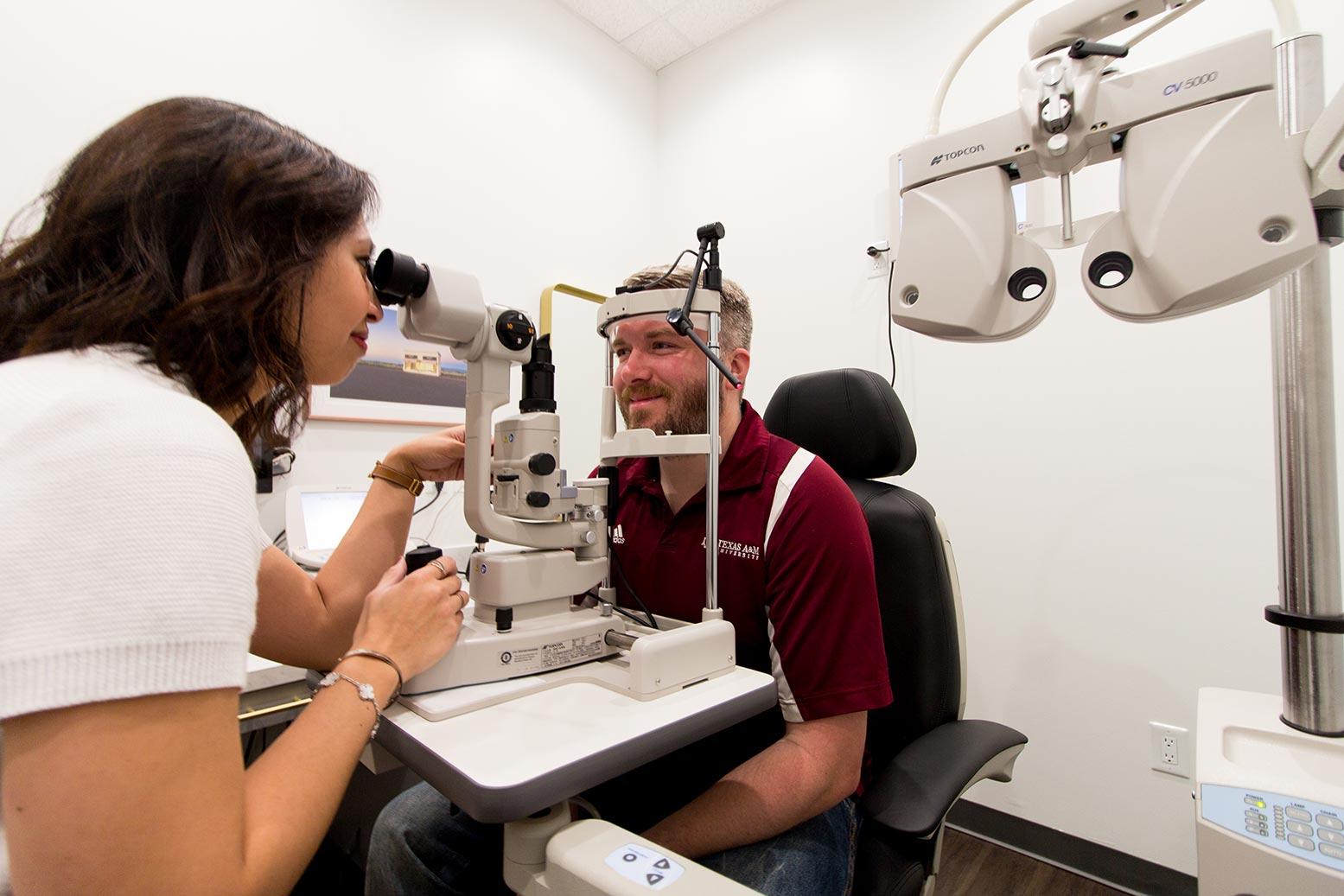 Man getting eye exam at Monocle Premier Eye Care   West University Place Optometry, Houston